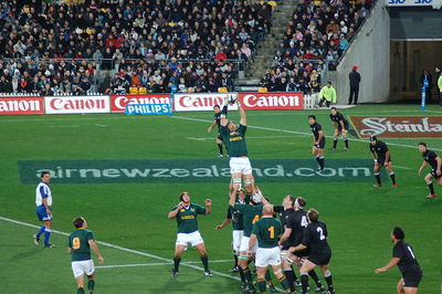 South African Victor Matfield claims a line-out ball in a 2006 Tri Nations Series test match. Source:Wikimedia Commons Photographer Hamish McConnochie .