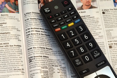 TV Remote on a Program Guide